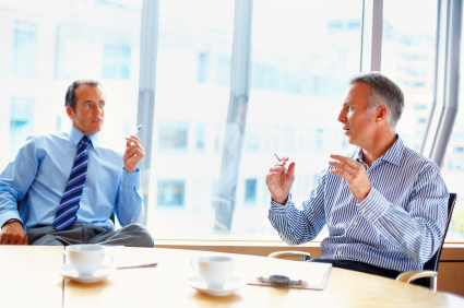 Business partners having discussion over coffee